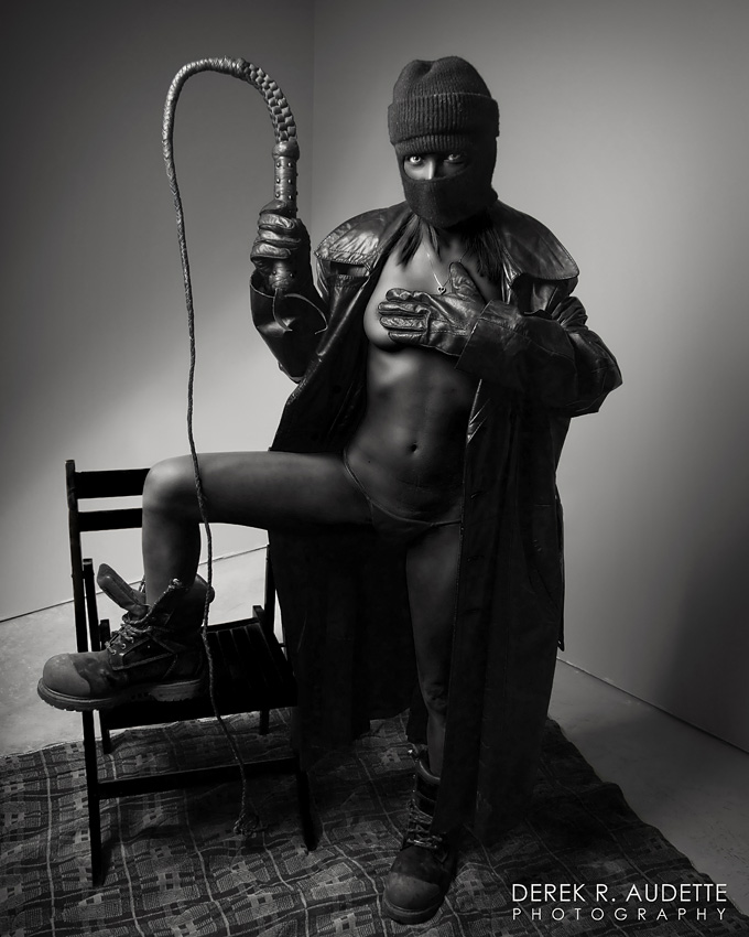 """Black Woman Holding Bullwhip"" - Photography by Derek R. Audette"