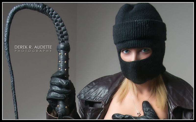 """Woman in Ski-Mask Holding Bullwhip"" - by Derek R. Audette"